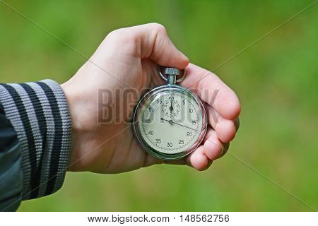 Stop watch in a hand.Stopwatch in hand athlete