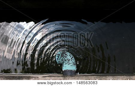 Drainage pipe and gutter with water drop.