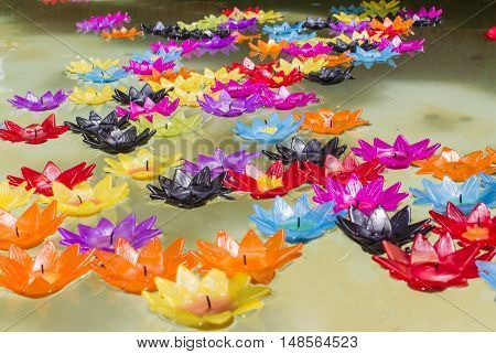 Candle in lotus design with float on the water