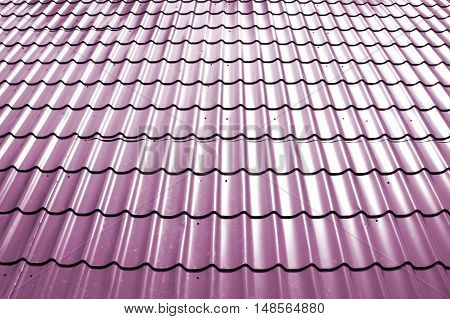 pictured metallic purple tiles on the roof close-up