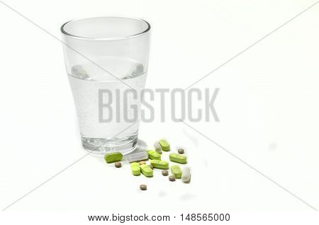 glass of water and medicine from the disease