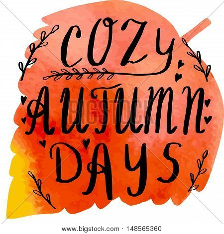 Hand written phrase Cozy Autumn Days on abstract hand painted watercolor texture in leaf shape. Colorful autumn foliage banner template with hand lettering isolated on white background. Vector illustration.