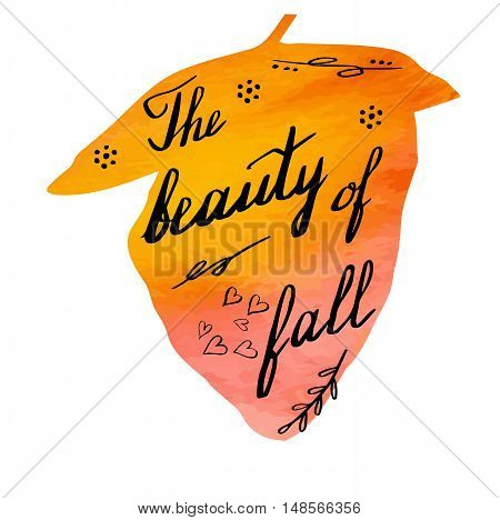 Hand written phrase The Beauty of Fall on abstract hand painted watercolor texture in leaf shape. Autumn foliage banner template with hand lettering isolated on white background. Vector illustration.