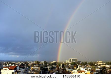 Double rainbow after storm over Lod city in Israel.
