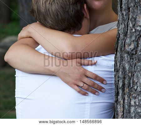 Couple photo, woman hug man, hands fragment,people in love, vintage photo. Passion