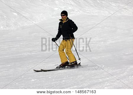 Skier Riding Fresh Powder Snow