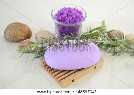 Natural soap with lavender on a stand, sprigs of lavender, sea salt with lavender