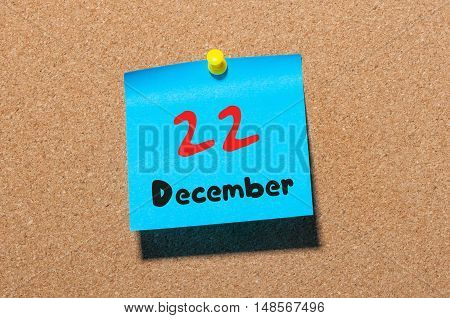 December 22nd. Day 22 of month Calendar on cork notice board. Winter time. Empty space for text.