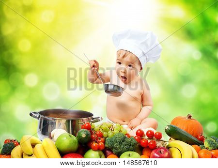 Baby boy in chef hat sitting with cooking pan and raw vegetables