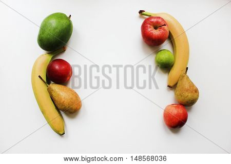 Colorful organic fresh fruits apple banana pear peach mango berries isolated on white table background Diet fitness planning, healthy eating food nutrition lifestyle concept with empty copy space for text close up