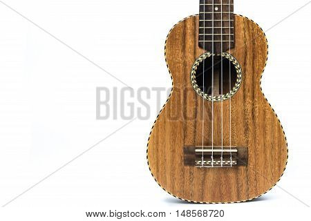 Close up ukulele isolated on white with copy space.