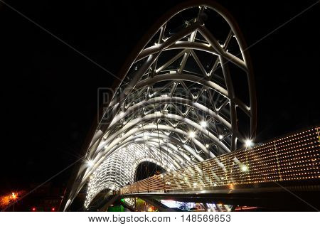 Tbilisi, Georgia 10.09.2016, Bridge of Peace Made from glass, night scene