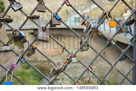 9,11,2016 Tbilisi, Georgia. Love locks on ancient brick bridge in abanotubani.