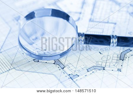 architecture blueprint -  house plans & magnifying glass