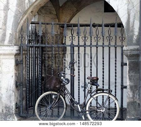REGENSURG,GERMANY CIRCA JUNE 2015, Bike parked by a iron gate.