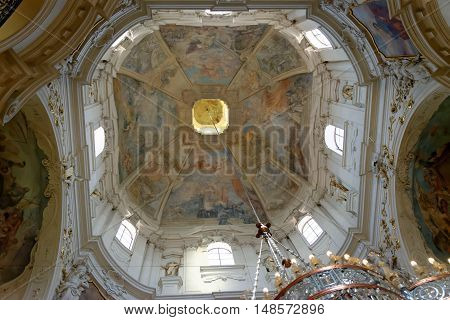 PRAGUE, CZECH REPUBLIC - JULY 3, 2014: The cupola of the church of St. Nicholas in Old Town Square. The frescoes are celebrating St. Nicholas and St. Benedict and depicting scenes from old Testament