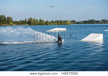 young man on wakeboard is ready to jump