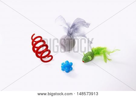 various colorful cat toys including toy mouse