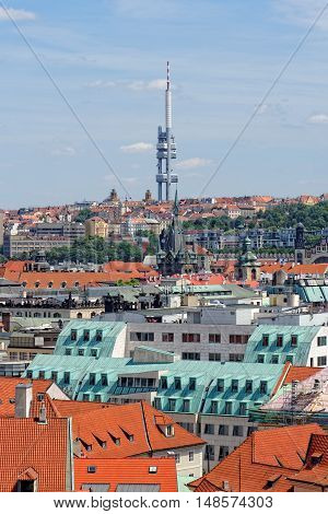 Aerial view of the traditional red roofs of the city of Prague Czech Republic with the Television tower in the distance. With its 216 m in height it's the tallest building in the city.