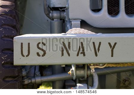 U.S Navy spraypaint on grey car bumper
