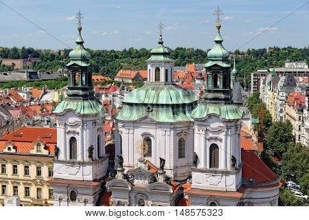 Aerial view of the towers of the St. Nicholas Church in the Old Town Square. It is a baroque church which abounds in best known acoustics in Prague thus becomes a place for classical concerts.