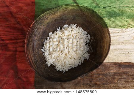 Poverty Concept, Bowl Of Rice With United Arab Emirates Flag