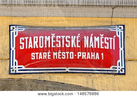 Old Town square (Staromestske Namesti). Traditional red street sign in Prague Czech Republic.