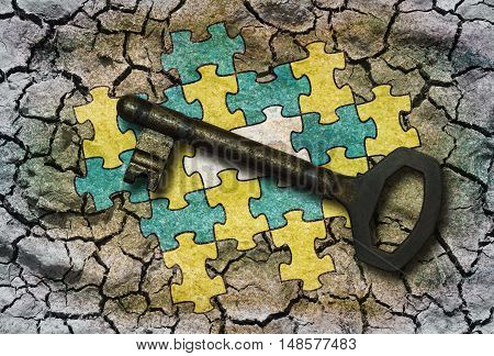 Conceptual illustration - Connected puzzle with one missing part and a key