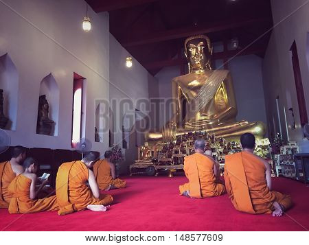 LOPBURI, THAILAND- Sep 23 2016 : Monks studying theology in the evening at the church.