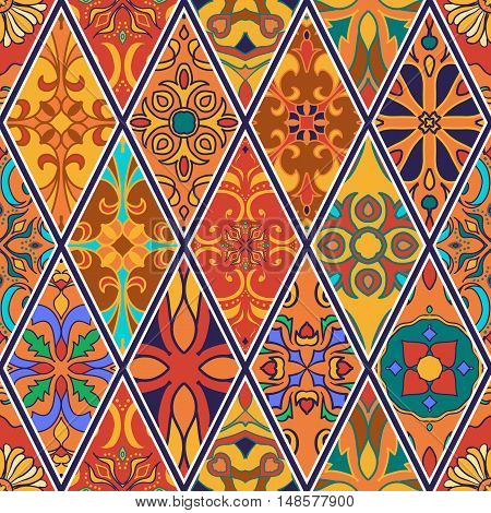 Vector seamless texture. Beautiful patchwork pattern for design and fashion with decorative elements in rhombus. Portuguese tiles Azulejo Talavera Moroccan ornaments