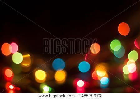 Lights blurred bokeh background from christmas night party for your design, vintage or retro color toned