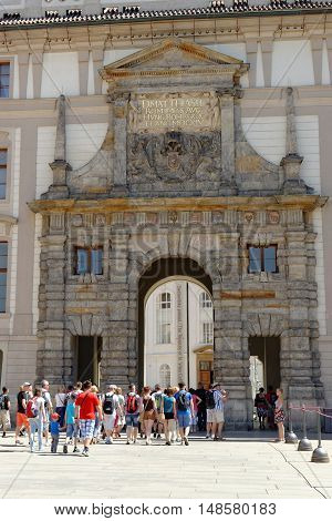 PRAGUE CZECH REPUBLIC - JULY 4 2014: Tourists at the Matthias Gate - the triumphal entrance gate to the Prague Castle from the first courtyard. It is the first Baroque structure at the Castle.