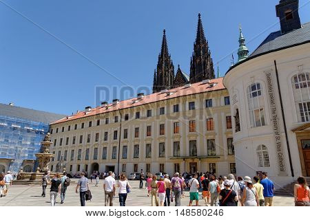 PRAGUE CZECH REPUBLIC - JULY 4 2014: Tourists in second courtyard of the Prague Castle most visited place in the Czech Republic.