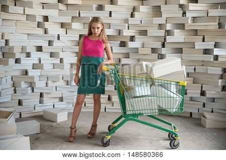 Model posing with trolley from the supermarket