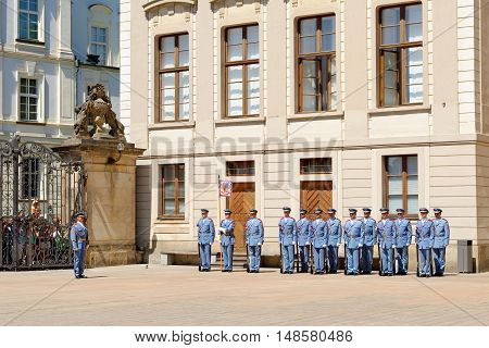 PRAGUE, CZECH REPUBLIC - JULY 4, 2014: Castle guards (Hradni straz) of presidential palace during ceremonial changing of guards. It takes place daily at noon accompanied by a brass band.