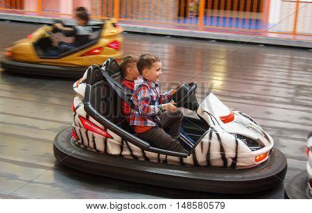 LUTSK UKRAINE - 16 April 2016: Children having fun driving electric toy car