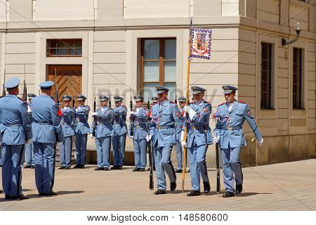 PRAGUE CZECH REPUBLIC - JULY 4 2014: Castle guards (Hradni straz) of presidential palace during ceremonial changing of guards. It takes place daily at noon accompanied by a brass band.