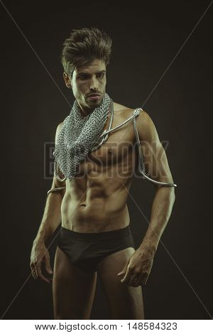 Fitness, muscular man brown hair, caucasian young Spanish naked torso with abdominal