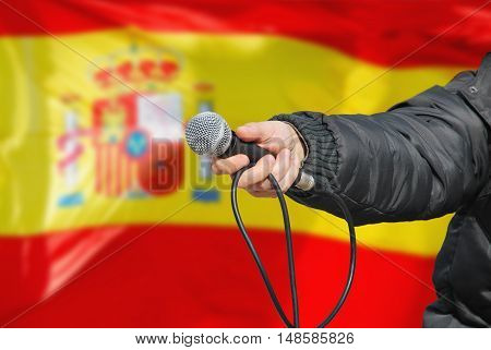 Hand Holding Microphone In Spanish Survey