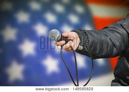 Hand Holding Microphone In American Survey