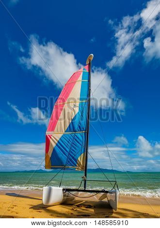 Catamaran sailboat on a beautiful summer day at Maenam Beach Koh Samui Thailand