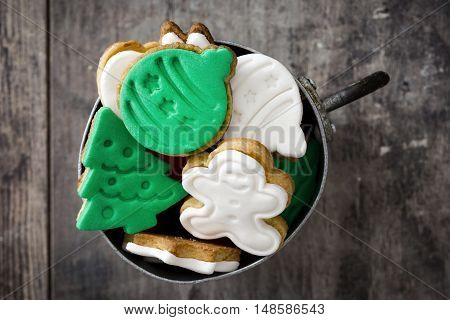 Christmas cookies in a metal cup on wooden table