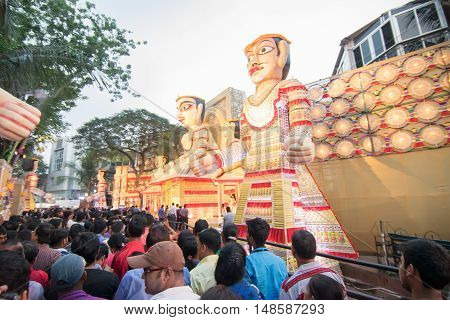 KOLKATA INDIA - OCTOBER 21 2015 : Crowd enjoying Durga Puja festival on road at Kolkata West Bengal India. Durga Puja is biggest religious festival of Hinduism.