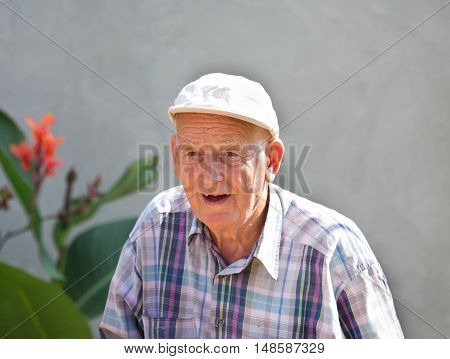 Smiling Old Man In Courtyard