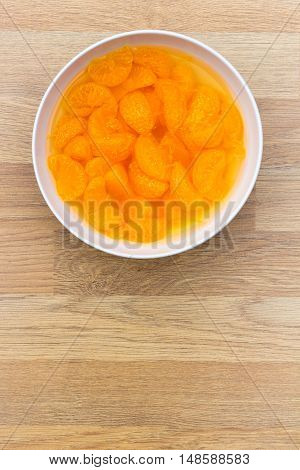 A bowl of mandarin segments - copy space provided.