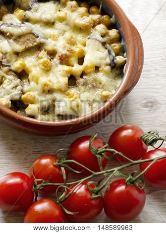 Baked vegetables with nuts,  cheese and tomatoes