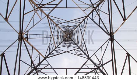 Large electricity pylon viewed from above below.