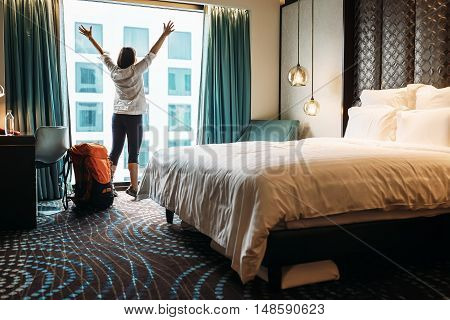 Backpacker traveller happy to stay in hotel