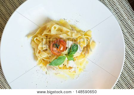 Pasta with chicken on a plate the italian food