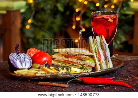 Sandwich With Red Fish On A Plate With Vegetables And A Glass Of Mulled Wine